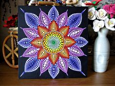 This is a great mandala - a bright, colorful and tactile.   I use acrylic paint and brush painting is painted on a wooden canvas. The painting is coated with acrylic lacquer. Size 20x20 cm 0,8 cm deep. It will bring you joy and comfort vvash house or house of your loved ones. Great as a gift for yourself or someone special to you.   Delivery my store: First delivery method via DPD (http://www.dpd.ru), delivery time 5-14 days, cost from $ 20 The second method of delivery through the ...