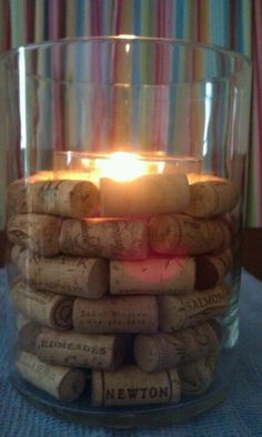 Easy candle holder with wine corks, a glass Yankee candle and a glass vase from a craft store.