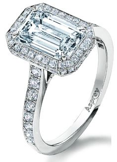 Asprey Victorian Mount halo engagement ring, set with a 2ct emerald-cut diamond. Via Diamonds in the Library.