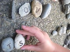 rock collection with letters on them for play outside.
