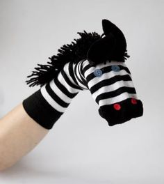 From buttonbag.co.uk:  zebra, dragon and monkey sock puppet tutorials and patterns.