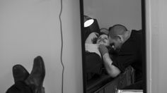 Relflection of the artist tattooing. B & W.Interesting perspective