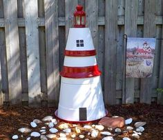 DIY Clay Pot Lighthouse for the Garden! http://www.completely-coastal.com/2015/04/backyard-ideas-coastal-living.html