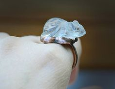 This is a unique copper and carved quartz crystal ring made in my studio. The quartz crystal is natural, it has been carved into a mouse form :) Very cute! Sits on your finger :) The setting is solid copper with patina and shine. Ringband is 2 mm wide wire, confortable. Stone size: 15 x 26 mm and about 12 mm high  Ring size: 6 3/4 US, just a bit under 7  I always search for the most inspiring gemstones and raw materials, choose extra ordinary shapes, juicy colours, anything interesting, ...