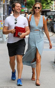 Taking a walk: Karlie Kloss (right) and fashion writer Derek Blasberg (left) took a walk o...