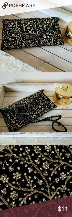 NWOT Gold Sequined Envelope Evening Bag Clutch Black velvet with gold thread embroidery and gold sequins. One credit card sized zipper pouch inside. Tuck the shoulder cord inside to use as clutch. Brand new, never used.  Do not habe tags.  Received as gift. Bags Clutches & Wristlets