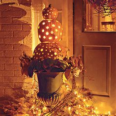halloween front porch decor.  I am pretty certain this was featured in southern living.  You can use real or fake pumpkins and put Christmas light in them.