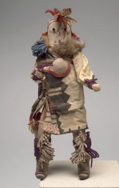 Pueblo, Zuni (Native American). Kachina Doll (Kjaklo), late 19th century. Wood, textile, leather, fur, feathers, pigment, shell, 14 1/2 x 6 x 4 1/4 in. (36.8 x 15.2 x 10.8 cm). Brooklyn Museum, Museum Expedition 1903, Museum Collection Fund, 03.325.4614. Creative Commons-BY (Photo: Brooklyn Museum, 03.325.4614.jpg)