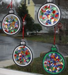 christmas crafts for kids - Christmas ornament window light catchers (contact paper sticky side up - add tissue paper - another sheet of contact paper, and cut out. Christmas Projects, Christmas Themes, Christmas Holidays, Holiday Fun, Christmas Crafts For Kids To Make At School, Christmas Baubles, Childrens Christmas Crafts, Christmas Decorations For Kids, Tree Decorations
