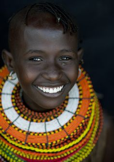 Smiling Turkana girl with giant bead necklances - Kenya