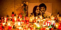 Hundreds of candles have been placed in front of a portrait of Slovak investigative journalist Jan Kuciak and his girlfriend Martina Kusnirova in the center of Bratislava in the night of February 27, 2018. The body of Jan Kuciak, a 27-year-old reporter for the aktuality.sk news portal owned by Axel Springer and Ringier, was discovered alongside that of Martina Kusnirova at their home in Velka Maca, 65 kilometres (40 miles) east of the Slovak capital Bratislava on February 26, 2018. / AFP…