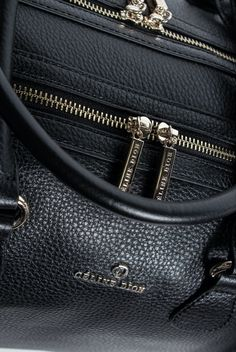0b5bc2e202 ADAGIO - DUFFLE BAG By Céline Dion   Double top zip leather duffle Tubular  straps Removable
