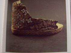 Look converse height tops.... Not really. Shoes belonging to Bishop Ridrigo Ximenez de Rada. 13th century