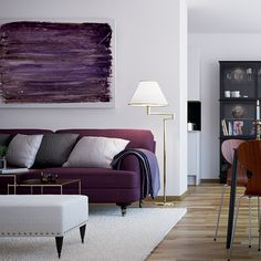 Scandinavian style the walls remain a vast white canvas, on which there's colorful splashes - purple/light grey/dark grey
