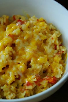 cheesy Mexican rice recipe--calls for broth, diced tomatoes in their juice, and cheese. I also add part of a bag of frozen mixed vegetables.