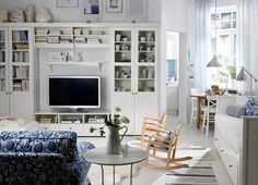 white living room / tons of storage and shelving
