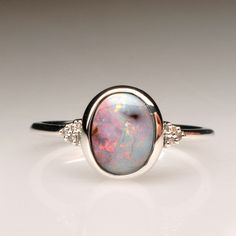 I love the colour of this stone. It would be beautiful set in rose gold with some grey spinel gemstones in the band.