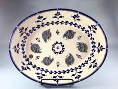 Stunning, hand designed oval platter by Dragana Jevtovic in the classic Blue Guinea Fowl design. Imported directly from Cape Town, South Africa by Vela Farquharson (Dragana Jevtovic Ceramics USA).  The oval platters features the South African Guinea Fowl in a cobalt blue color that has been mixed by the artist with textured 3-D dots and footprints.  #africa #draganajevtovic #platter