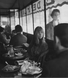 She Waits For Him at a café in paris