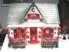 Chloe and I have been having fun looking at Christmas dollhouses for inspirations. We loved this Christmas house.