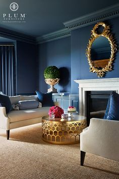 Chic Living Room | Blue Room | Blue Walls | Gold Mirror | Gold Table | White Couch | Glamorous Room