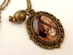 Nostalgic Necklace in bronze with compass and old books, navigation necklace, oval necklace, glass necklace, cabochon jewelery - pinned by pin4etsy.com