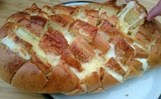 warm-three-cheese-stuffed-bread-served