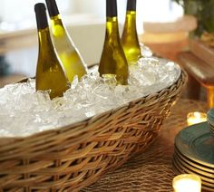 Woven Rattan Canoe Drink Cooler | Pottery Barn - Great idea for outdoor gatherings.