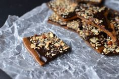 Seriously, is there anything better than caramelized sugar? Ok, maybe caramelized sugar, a stick of butter, lightly toasted almonds, and a glorious robe of melted chocolate. Heaven help me, this stuff is amazing!