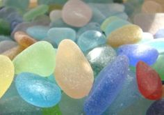 sun shines one jar of prettiest sea glass. Ocean of aquas, yellow, pink, red and more.