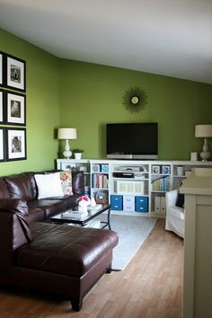 Ikea bookcases pieced together to create 'built-ins'  -i would like to get another bookshelf, paint them a fun color & put the TV on top like this...then where the bookcases are put a storage bench.