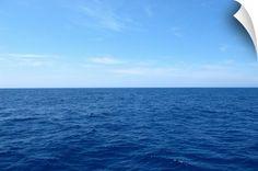 Deep blue Mediterranean sea water with clear blue summer sky in Ajacio, Corsica, France.