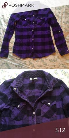 Purple Plaid Flannel Gently used purple flannel from Delias. Pearly colored buttons and snaps on the sleeves to keep them rolled in place. Delia's Tops Button Down Shirts
