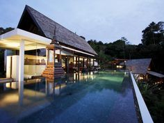 Located in gorgeous Phuket, Thailand, this stunning property boasts over 8,000 square feet of interior space and over 8,500 square feet of outdoor terrace space as well! Situated on the waterfront, this property is simply beautiful
