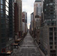 Stranger crossing an empty street in an empty city. - Imgur