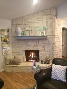 Austin stone fireplace! Creates a warm home with off white and gray accents.  Home sweet transitional home.