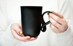 Get twisted with this charcoal black porcelain big mug from ENDE ceramics. Handmade in meticulous detail, the cup is tall and smooth while the Porcelain Mugs, Ceramic Clay, China Porcelain, Porcelain Jewelry, Ceramic Bowls, Pottery Mugs, Ceramic Pottery, Thrown Pottery, Slab Pottery