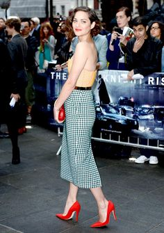 Marion Cotillard - way to swing a midi length skirt!