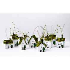 Home Decorations Miniature of ten houses of green roofs Welcome Home... ($55) ❤ liked on Polyvore featuring home, home decor, holiday decorations, miniature christmas tree ornaments, green home accessories, green home decor, green christmas ornaments and mini christmas ornaments