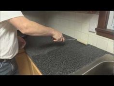 Rustoleum countertop transformation kit for the kitchen, a real person doing it on a countertop just like mine.