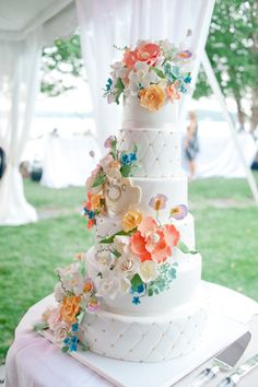 Check out these colorful flowers on this wedding cake!