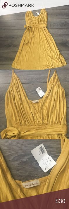 Deep V Neck Dress Mustard yellow colored dress with a deep V neck. Has a matching belt. Brand new with tag!!! Honey Punch Dresses Midi