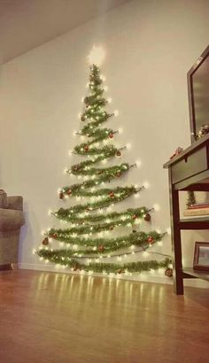 Easy Christmas Decor From simple to amazing Notable tips and tricks to form a fun and charming simple christmas decor diy xmas trees . Xmas image provided on this day 20190114 , exciting post reference 3707337813 Wall Christmas Tree, Noel Christmas, Xmas Trees, Diy Christmas Wall Decor, Christmas Tree Made Of Lights, Tinsel Tree, Outdoor Christmas, Christmas Tree Simple, Creative Christmas Trees