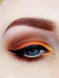 Brows and orane eyeshadow. Great for halloween.