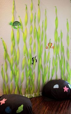 """Seaweed streamers and rock """"pillows"""" for a photo booth! #BirthdayExpress #MermaidParty"""