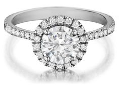 Check out this fantastic HENRI DAUSSI brilliant round diamonds engagement ring, available in your choice of metals!