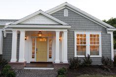 bluish gray cedar shingles complimented by a muted yellow door}Hooked on Hickory: Goodbye Summer