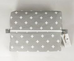 Back in Stock!  Swisscross Toiletry Bag.  Also great as a First Aid Bag!  http://ift.tt/1LMhqo9  #cosmeticpouch #design #gray #toiletrybag #hair #bag #shopping #swisscrosslover #grayandwhite #gifts #fireboltcreations #etsy #swiss #swisscross #etsyseller #etsyelite #handmade #handcrafted #zipperbag #design  #february #makeup #firstaidkit #firstaid #stockingstuffer #storage #modern #vacation #travel #travels