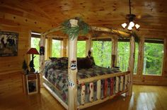 Kate's Cove - 2 bedroom cabin with leather furnishings, log bed, a staked stone fireplace and a great game room! #secluded #cabin