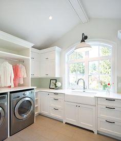 Laundry room w/white cabinets and bronze hardware, white quartz counter tops in Caesarstone Organic White, a white farmhouse sink, vintage white gooseneck pendant
